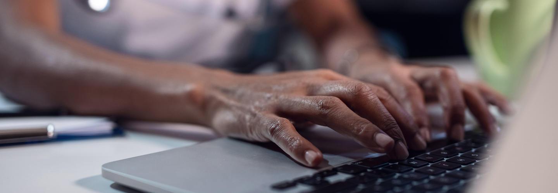 Healthcare Worker Using Laptop