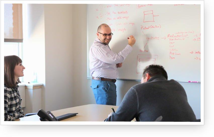 Alex-whiteboard-meeting