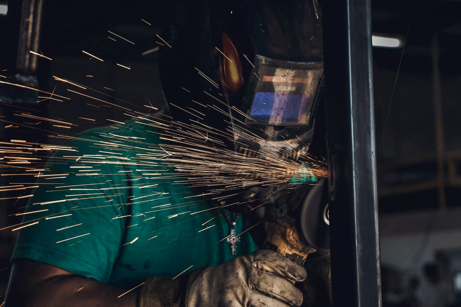 person using tool wearing protective equipment