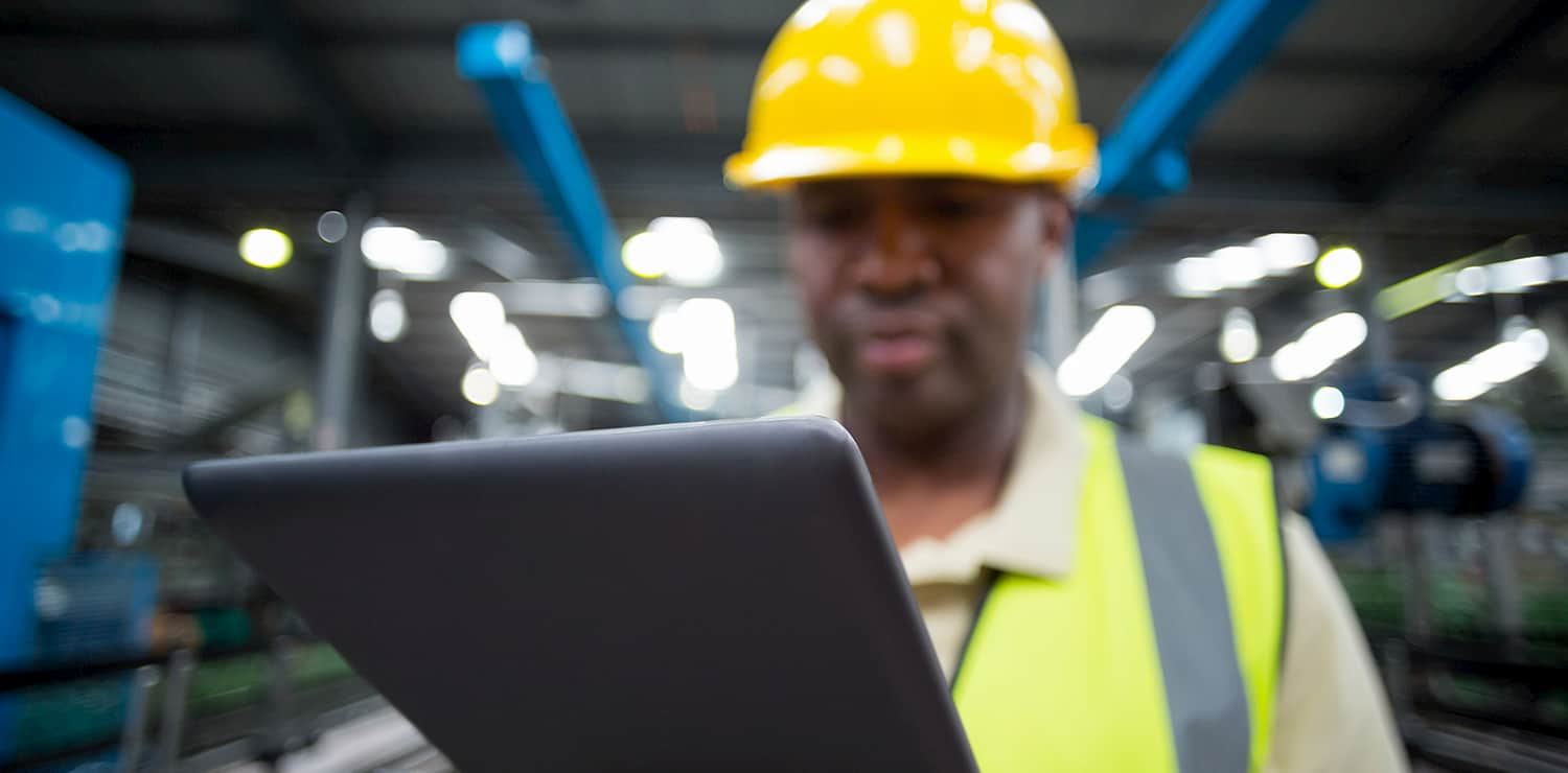 worker with yellow hard hat and ipad