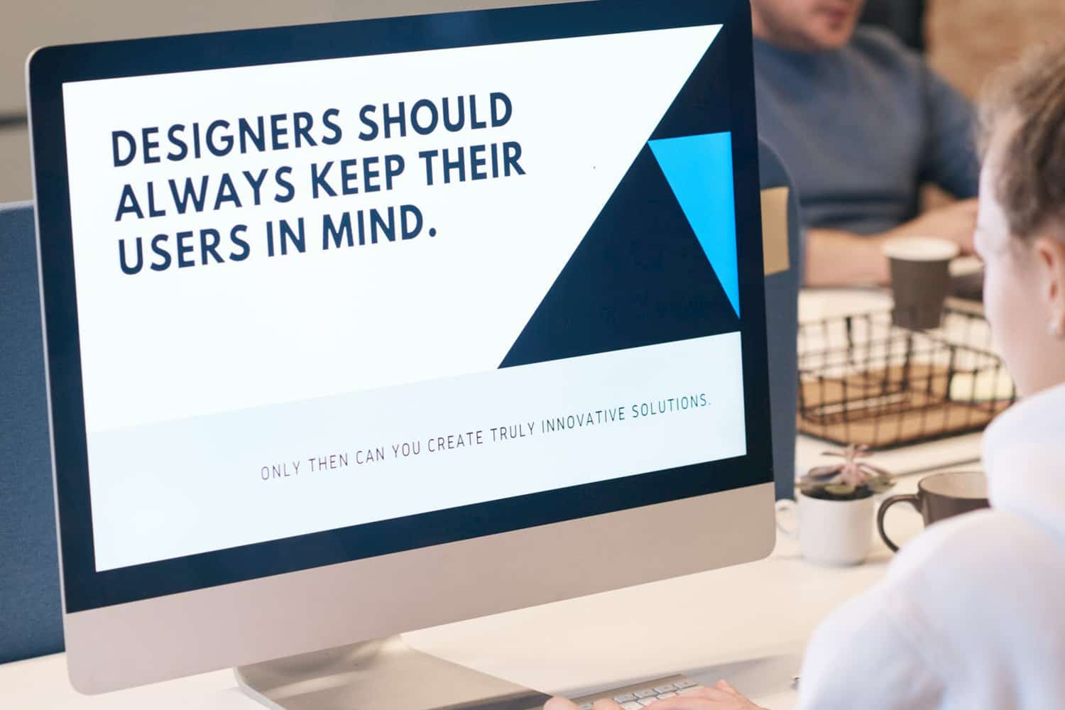 "UX Quote on screen: ""Designers should always keep their users in mind"""